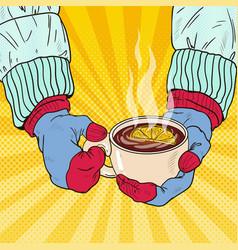 hands in mittens holding cup with hot tea vector image