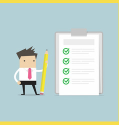 businessman holding a pencil and checklist vector image vector image