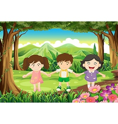 Three playful kids at the jungle vector
