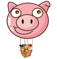 A pig balloon carrying a basket with kids vector image