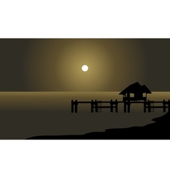 Silhouette of hut and pier vector
