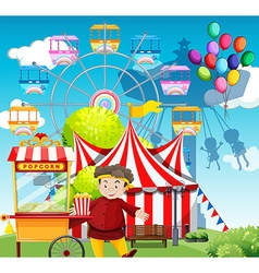 Man selling popcorn at the funpark vector image vector image
