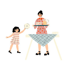 girl helping her mother set table family vector image