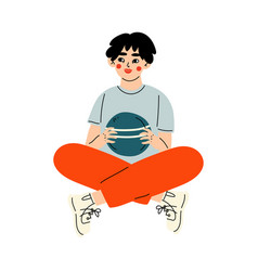 tennage boy sitting cross legged and holding ball vector image