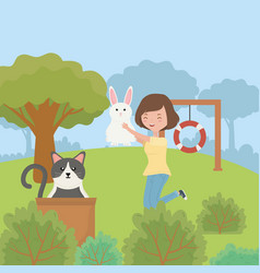 Woman with rabbit and cat with box in park pet vector