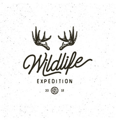 Vintage wilderness logo hand drawn retro styled vector