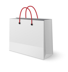 Classic paper shopping bag with red handles vector