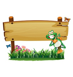 An empty wooden signboard with a playful frog vector image