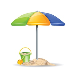 Bucket and sand under umbrella vector
