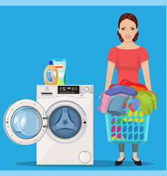 Cheerful girl standing and holding laundry basket vector