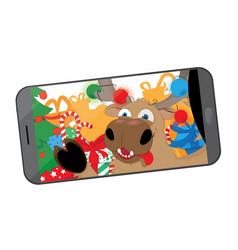 Funny reindeer taking a selfie in santas workshop vector