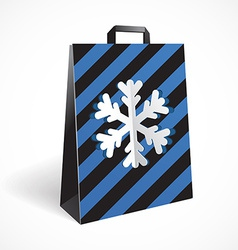 Festive black striped paper-bag with cut out vector image
