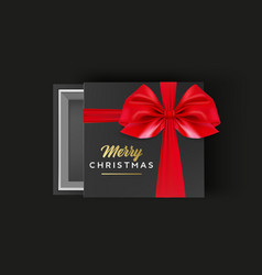 gift box with red ribbon bow and merry christmas vector image