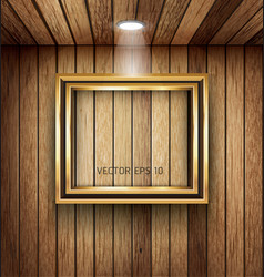 Gold frame on wood wall with spotlight vector image