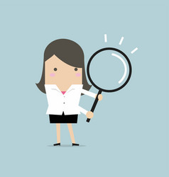 businesswoman with a magnifying glass vector image