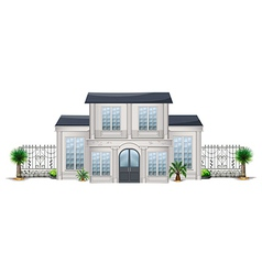 A big house with palm plants vector image