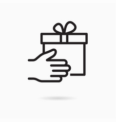 Gift box in hand line icon on white background vector