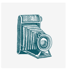 Photo camera vintage engraved hand drawn in vector