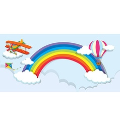 Airplane and balloon over the rainbow vector