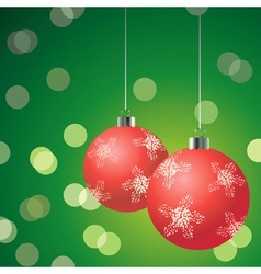 red christmas balls on the green background vector image