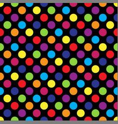 Seamless colorful polka dot pattern on black vector