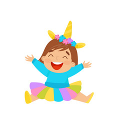 happy baby girl in unicorn costume sitting on the vector image