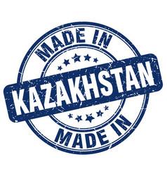 made in kazakhstan blue grunge round stamp vector image