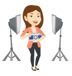 Photographer with camera in photo studio vector