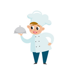Chef in uniform in restaurant kitchen cooking vector