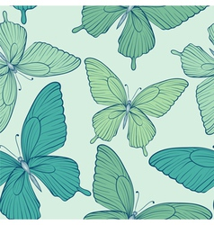 Seamless background with blue butterflies vector