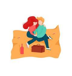 young man and woman sitting on blanket embracing vector image