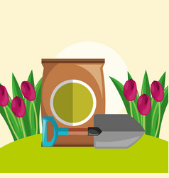 Potting soil shovel and red tulips flowers garden vector