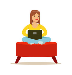 happy young woman sitting in a red pouf and using vector image vector image