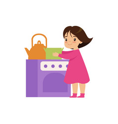 Sweet little girl playing with toy kitchen oven vector