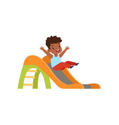 Cute little african american boy sliding down the vector
