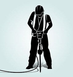 Silhouette of a worker with a jackhammer vector image