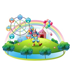 A clown with balloons at the carnival in the vector image