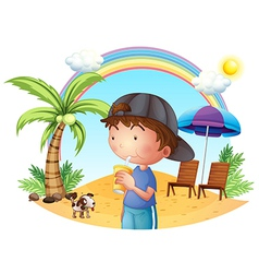 A young boy at the beach with his pet vector image
