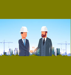 two businessmen builders handshake agreement vector image