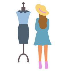 woman looking on dress at dummy isolated person vector image