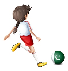A girl kicking the ball with the flag of Pakistan vector