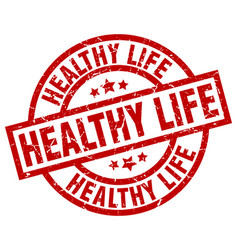 healthy life round red grunge stamp vector image
