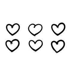 sprayed graffiti hearts set in black on white vector image
