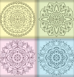 Four circular floral ornaments vector