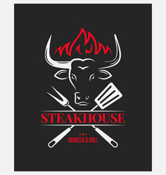 steakhouse logo with bull head on dark background vector image