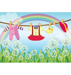Kids clothes hanging near the grass vector