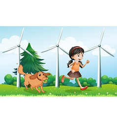 A girl playing with her dog near the windmills vector image