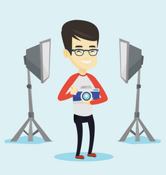 photographer with camera in photo studio vector image vector image
