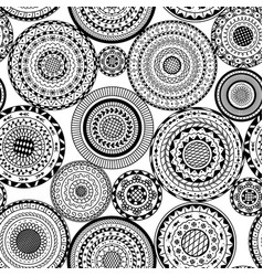 seamless pattern from ethnic round mandalas vector image