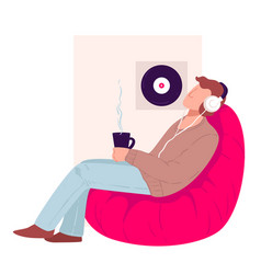 Man drinking tea listening to music at home vector